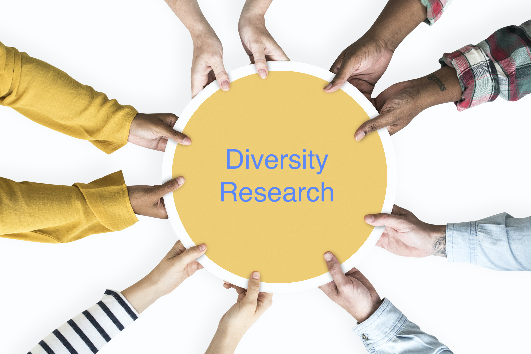 Diverse hands supporting a blank yellow round board